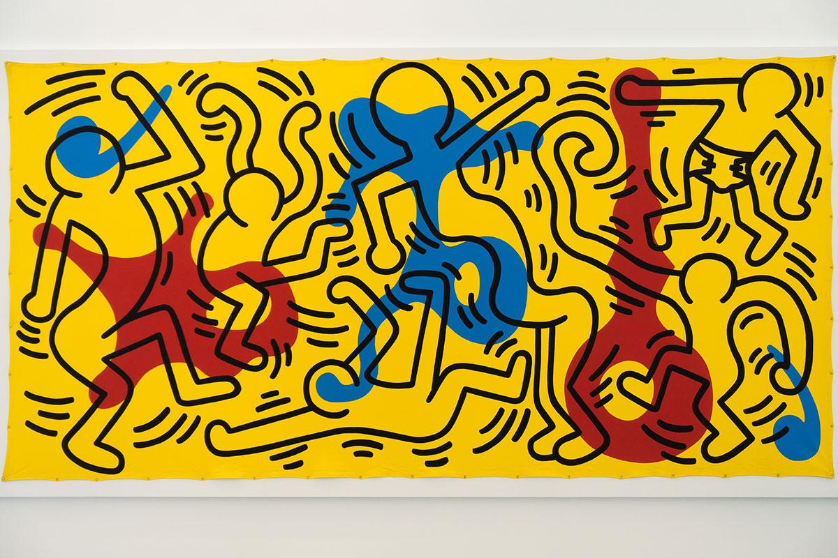 Keith Haring Pop-Art-Persiflage Tanzende Menschen, einer davon mit Windel